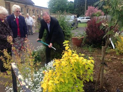 Rev Peter Hancock planting the anniversary tree